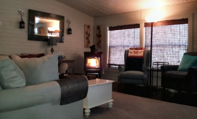 View of front with lit Harman Pellet Stove