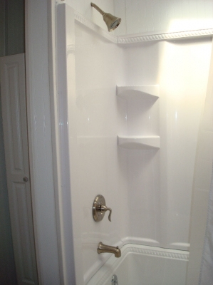 New shower surround with fixtures
