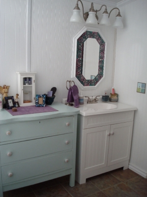 New sink vanity with free dresser painted and new decorative knobs.