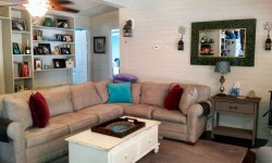 Finished knotty pine living room.