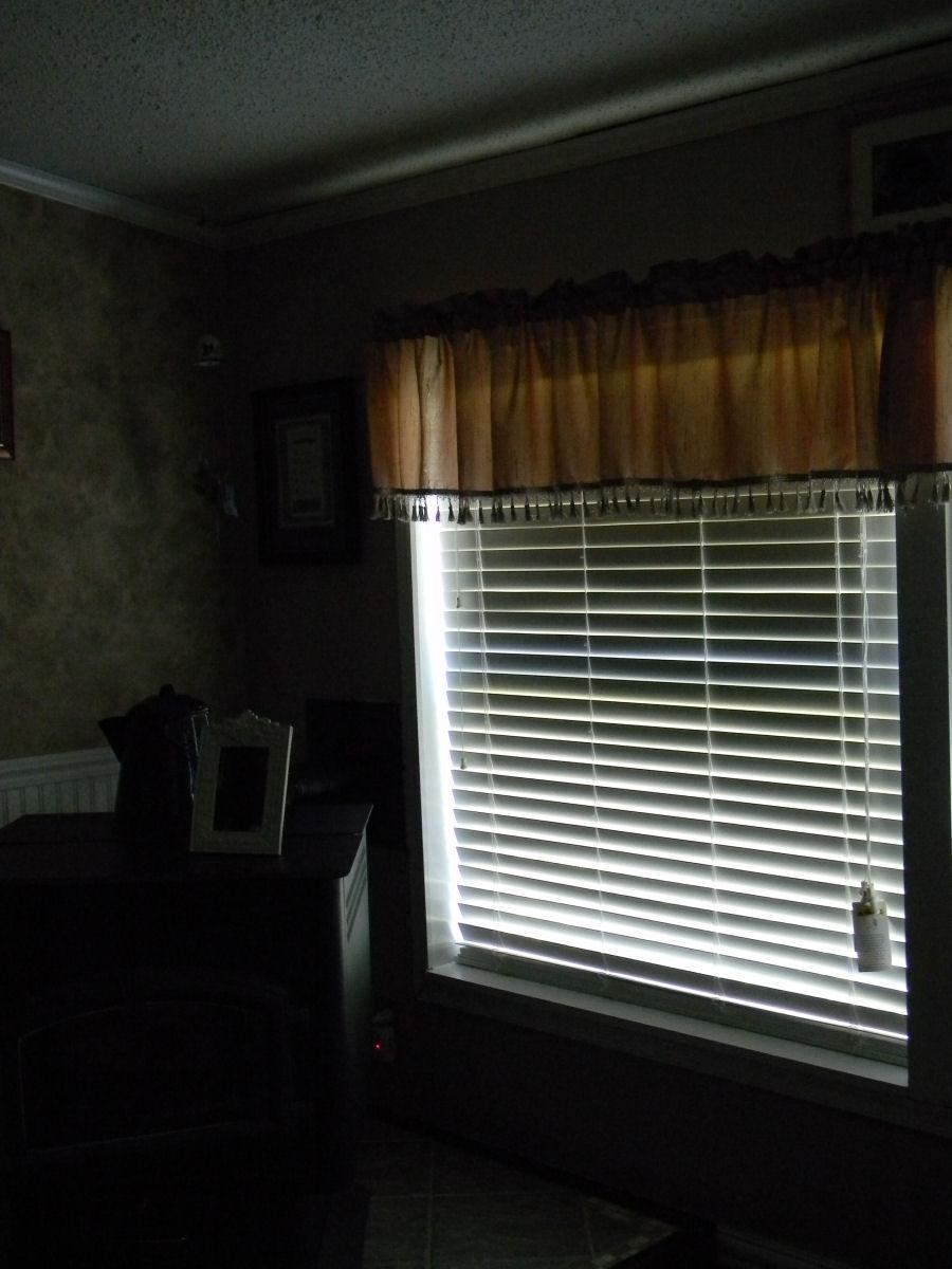 Room Darkened By Plantation Blinds